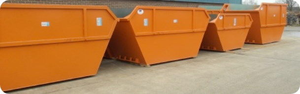 Row of open skips at 2 recycling