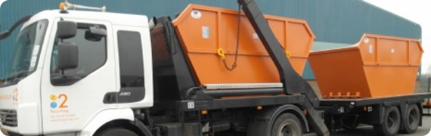 Two open skips for hire on a 2recycling lorry